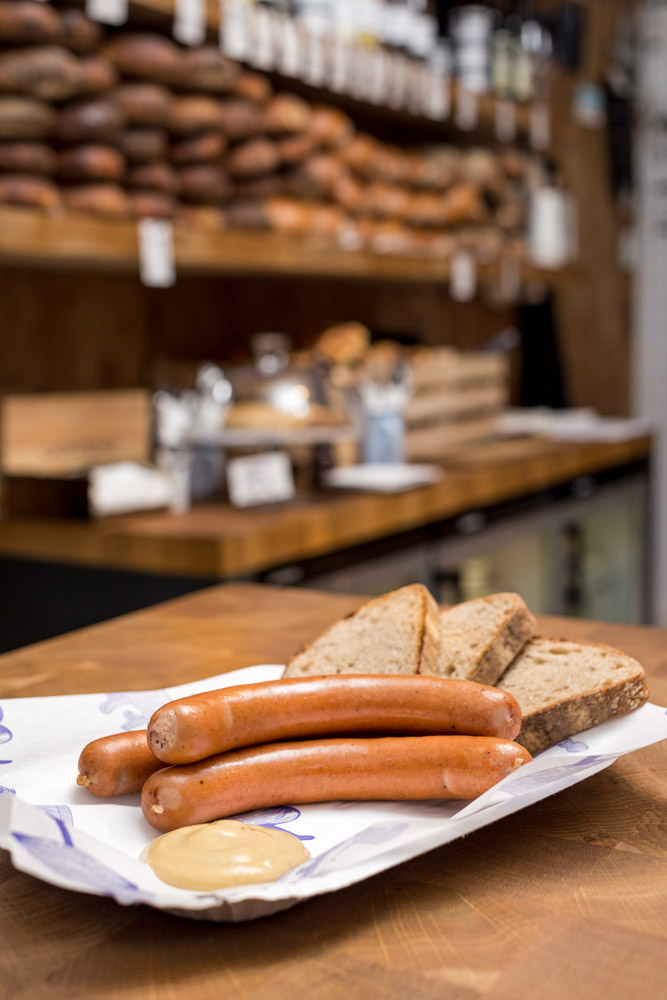 Our butcher´s sausages, homemade mustard and freshly-baked bread