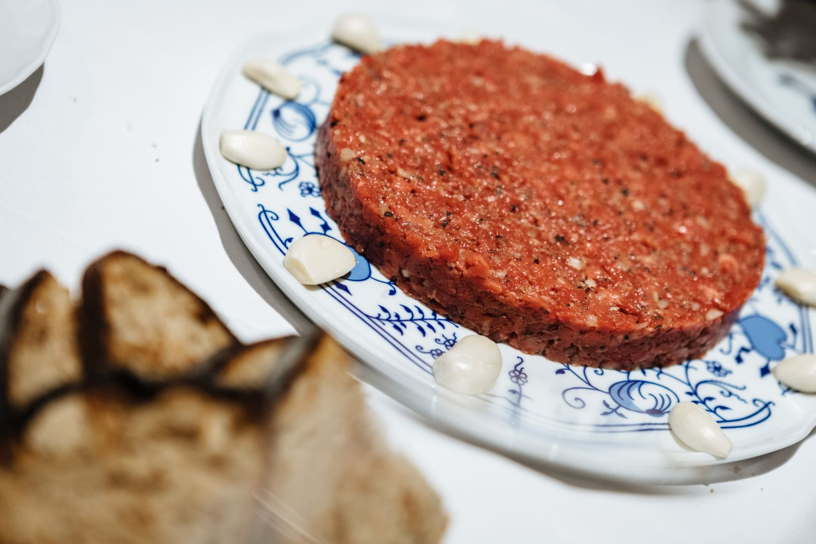 A substantial portion of beef tartare hiding a secret ingredient, can you identify it?